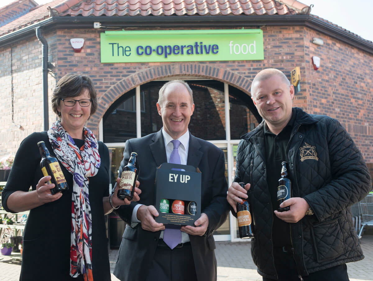 Coop new store opening with local suppliers for PR